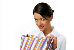 Attractive brunette peeping into paper bag Stock Photo