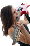 Attractive brunette playing electric guitar with t Royalty Free Stock Photo