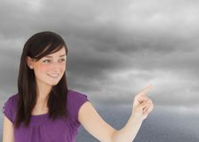 Attractive brunette pointing something with her finger Stock Image