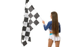Attractive brunette posing with checkered flag Royalty Free Stock Photos