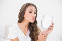Attractive brunette posing in front of mirror Stock Photo