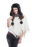 Attractive brunette posing with fur hat Royalty Free Stock Images