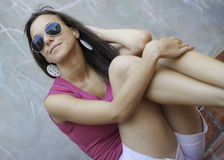 Attractive brunette posing with sunglasses Royalty Free Stock Photo