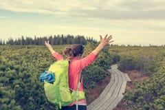 Attractive brunette raising hands while enjoying the view. Hiking Lovrenska lake, Slovenia stock photos