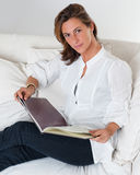 Attractive brunette reading a book Stock Photos
