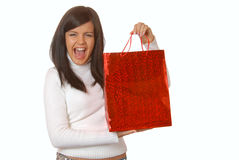 Attractive brunette with a red shopping bag Royalty Free Stock Image