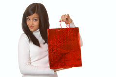 Attractive brunette with red shopping bags Stock Image