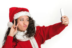 Attractive brunette santa girl taking self portrait Royalty Free Stock Photography