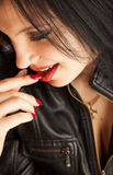 Attractive brunette girl touching your lips Stock Photo