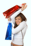 Attractive brunette with shopping bags Stock Photos