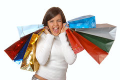 Attractive brunette with shopping bags Royalty Free Stock Images
