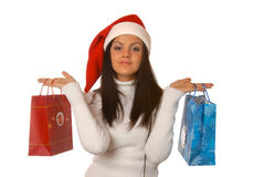 Attractive brunette is shopping with a Christmas hat Stock Image
