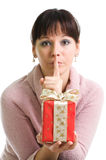 Attractive brunette shows secret Christmas present Stock Photography