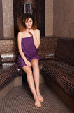 Attractive brunette sitting in steam room and taking a bath Royalty Free Stock Photos