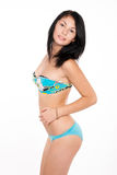 Attractive brunette slender girl in swimsuit Royalty Free Stock Images
