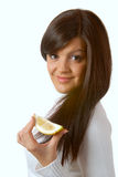 Attractive brunette with a slice of a lemon Stock Image