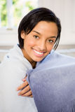 Attractive brunette on the sofa under blanket Royalty Free Stock Photo