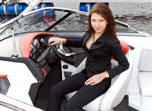 Attractive brunette in sporting cutter Stock Images