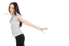 Attractive brunette spreading her hands Stock Photos