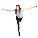 Attractive brunette standing on one leg, spreading her hands Stock Photos