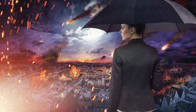 Attractive brunette staring at the natural disaster Stock Image