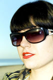 Attractive brunette in sun glasses Stock Photos