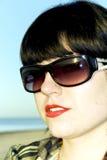 Attractive brunette in sun glasses Stock Photos
