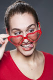 Attractive brunette with sunglasses and tongue out Stock Images