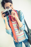 Attractive brunette taking a photograph Stock Photos