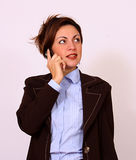 Attractive brunette talking on the cell phone Stock Images