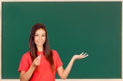 Attractive brunette teacher with a chalk Stock Photos