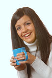 Attractive brunette with teacup Royalty Free Stock Images