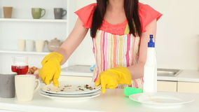 Attractive brunette tidying the kitchen Stock Photo