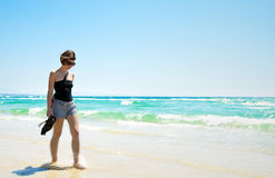 Attractive Brunette Walking Along Beach Royalty Free Stock Photos