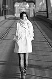 Attractive brunette walking at empty bridge Royalty Free Stock Image