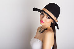 Attractive brunette wearing a big black hat Stock Photography
