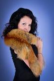 Attractive brunette wearing fox Stock Images