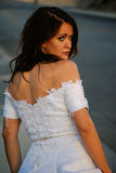 Attractive brunette in a wedding dress Royalty Free Stock Photos