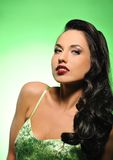 Attractive brunette woman. Isolated on green background royalty free stock photo