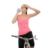 Attractive brunette woman with bike Royalty Free Stock Photos