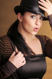 Attractive brunette woman in black hat Stock Photos