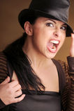 Attractive brunette woman in black hat Stock Photography