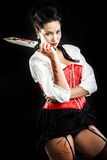 Attractive brunette woman with bloody knife Royalty Free Stock Images