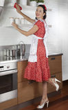 Attractive brunette woman cleaning kitchen Royalty Free Stock Images
