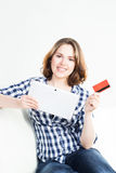 Attractive brunette woman with a credit card and a tablet comput Royalty Free Stock Image