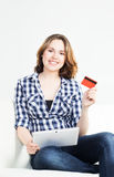 Attractive brunette woman with a credit card and a tablet computer Stock Images