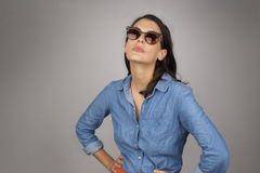Attractive brunette woman in dark glasses Royalty Free Stock Image