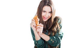 Attractive brunette woman eating a croissant on isolated background. Attractive brunette woman eating a croissant on isolated background Royalty Free Stock Images