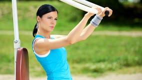 Attractive brunette woman exercising in outdoor Stock Photos