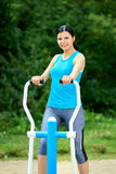 Attractive brunette woman exercising in outdoor Stock Images